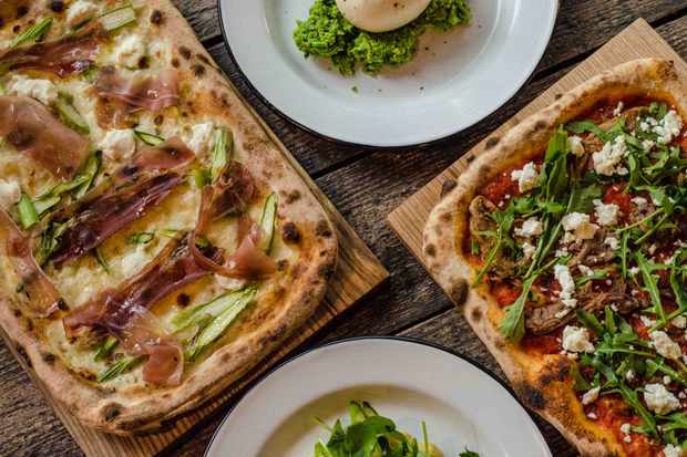 Pizzas on wooden boards at Heist Bank Paddington