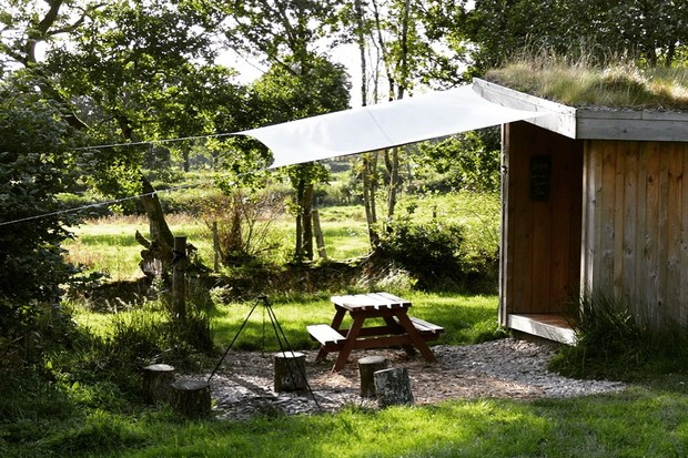 A sun-dappled cabin at One Cat Farm, Wales