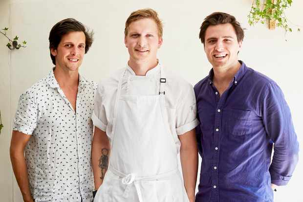 From left to right; Toby Neill, Johnnie Crowe and Luke Wasserman all standing together in front of a white wall.