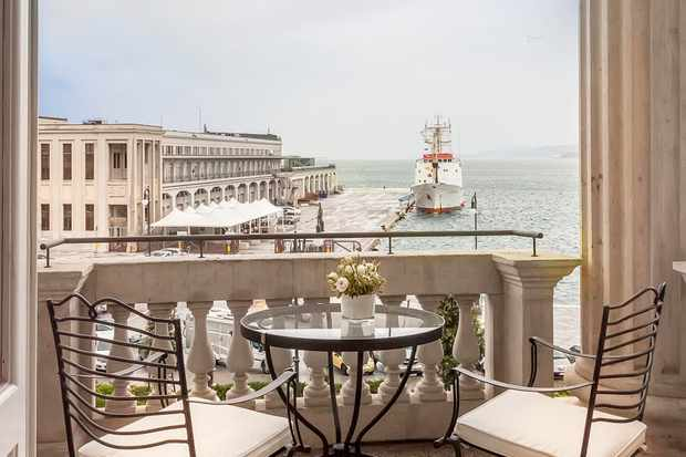 A deluxe room overlooking the sea at Savoia Excelsior Palace