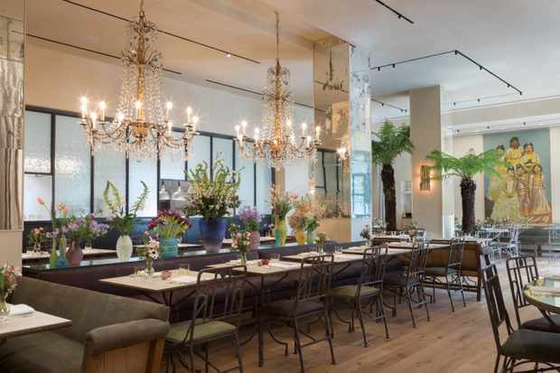 Grand chandeliers and tables with mirrored tops at The Petersham