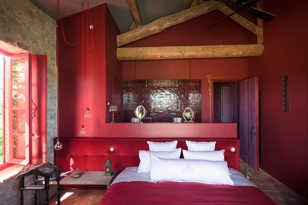 Bedrooms at Village Castigno with deep red furnishings