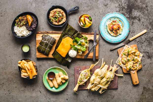 A layout of lots of dishes at Arepa and Co