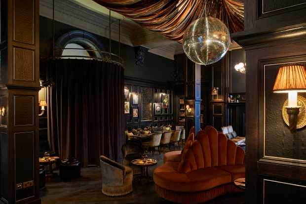 A striking glitterball hangs from the ceiling at Fitz's Bar in London's Principal Hotel