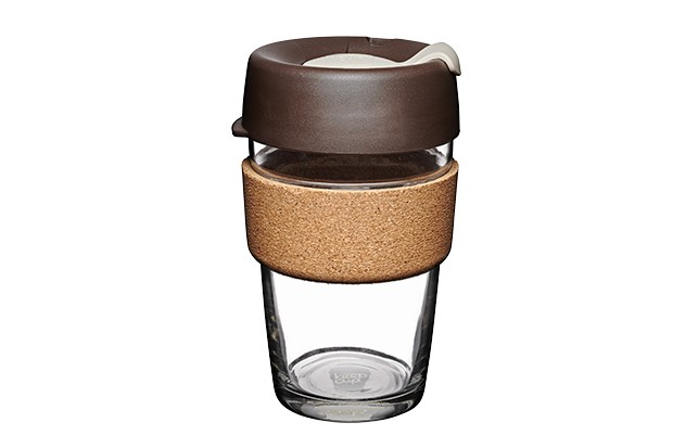 A reusable glass cup with a cork heat proof layer and a brown lid
