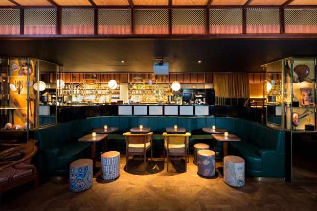 Blue banquette infront of a large bar
