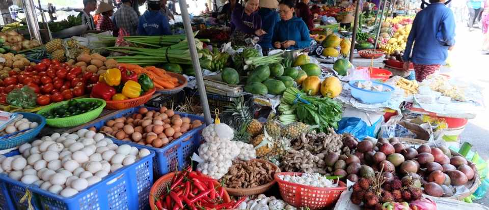 Local market in Vietnam selling fresh produce including fruit and veg