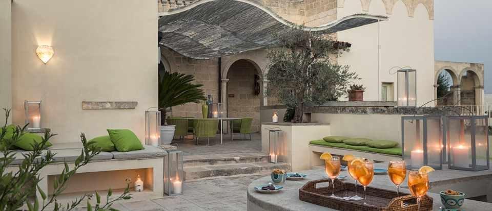 A terrace with aperol spritzes laid out