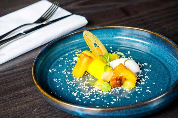An impressive dessert of – roasted pineapple, chai parfait, coconut sorbet