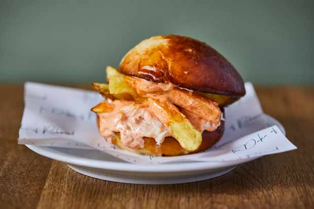 Crab and chips brioche burger at Duke of Richmond. Credit Steve Ryan