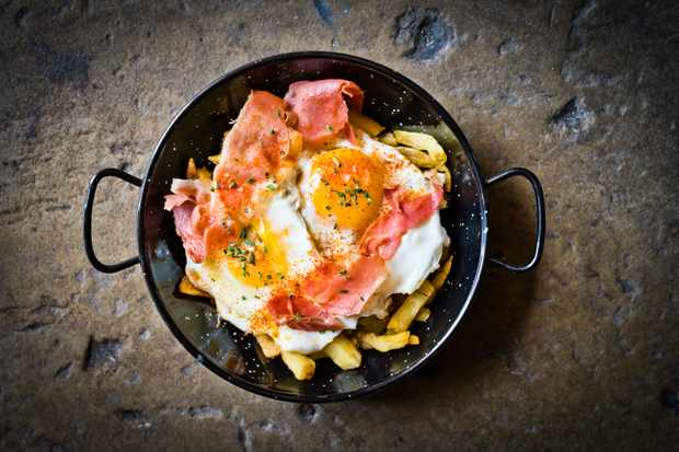 Ham and eggs on chips in a pan at Lunyalita Liverpool