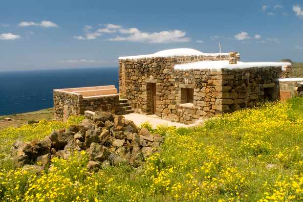A Dammuso, traditional stone house of Pantelleria island, with roof used to collect rainwater.