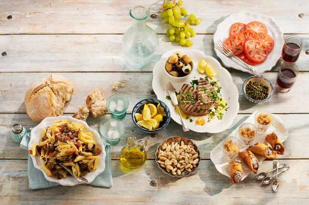 Sicilian lunch, including pasta alla norma, Pesce spada in salmoriglio, granita di caffe espresso, toasted almonds, cannoli