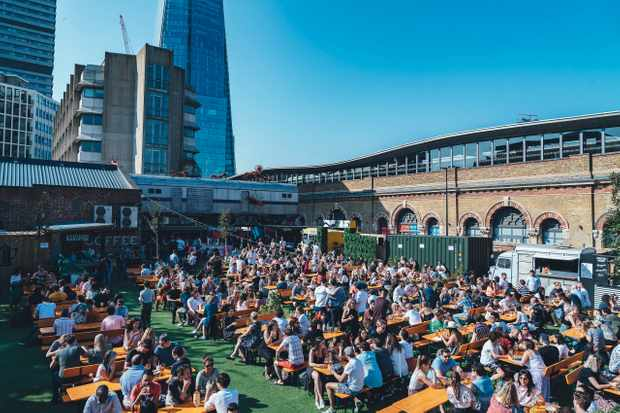 A terrace with a view of the Shard full of people Vinegar Yard London Bridge