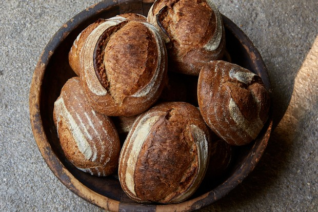 A basket filled with loaves of sourdough bread at Jolene, Newington Green