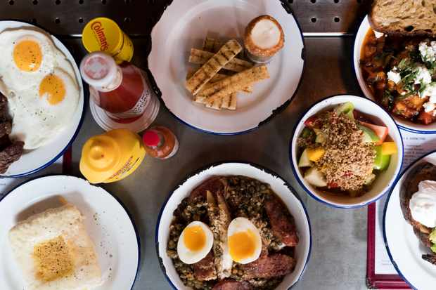 A selection of brunch dishes at Spuntino, Soho including eggs and steak, fruit salad and poached eggs on toast
