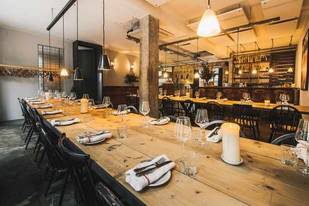 Wooden tables in Carousel Marylebone Restaurant