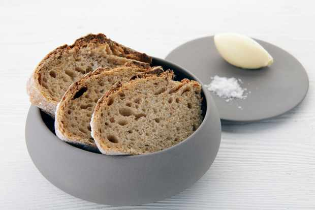 Chunky homemade beremeal sourdough with home-churned butter