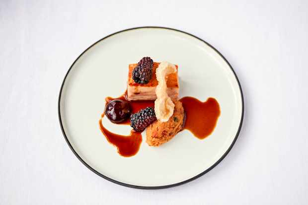 Pork belly dish on a white plate at Home Leeds