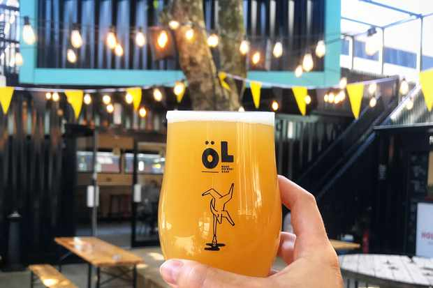 A glass of beer in front of fairy lights at Hatch Manchester
