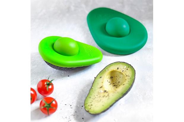 An avocado with an avocado hugger, a device that stores the de stoned avocado