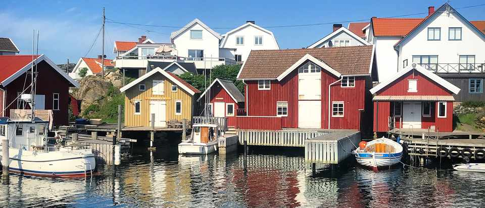 Red and white houses on the harbour of Mollosund West Sweden