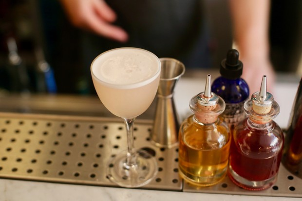 Cocktail and syrups at the bar at Ceremony Restaurant London