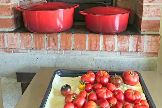 Tomatoes and red casserole dishes at Agrarian Kitchen Tasmania