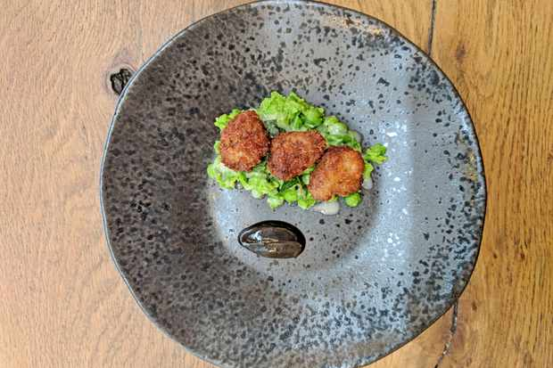 Deep-fried duck hearts on crushed minty peas