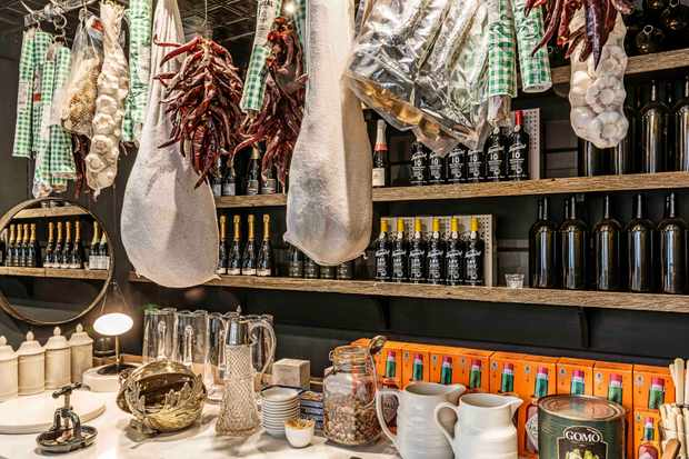 Beckford Bottle Shop wine bar counter lined with jars of nuts, nibbles and bottles of wine