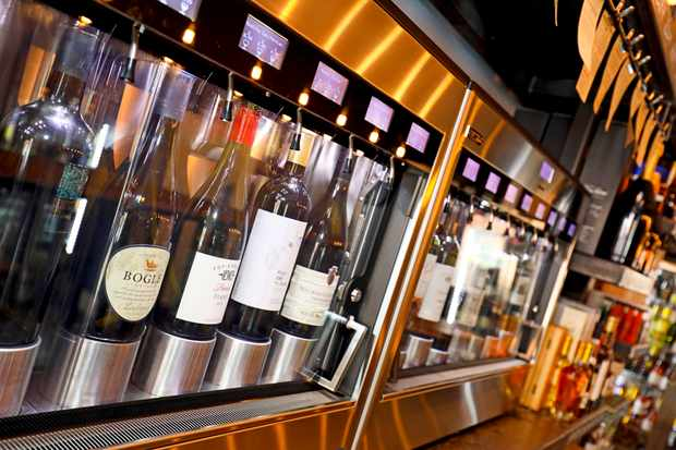 A wine bar with wine dispensing machines