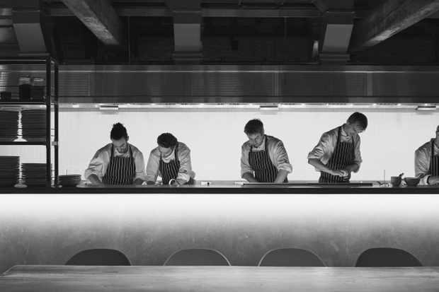 Chef Charlie Hibbert and his team behind the pass at the Ox Barn at Thyme