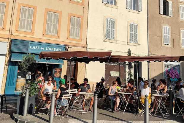 Tables outside Cafe de L'Abbaye Marseille