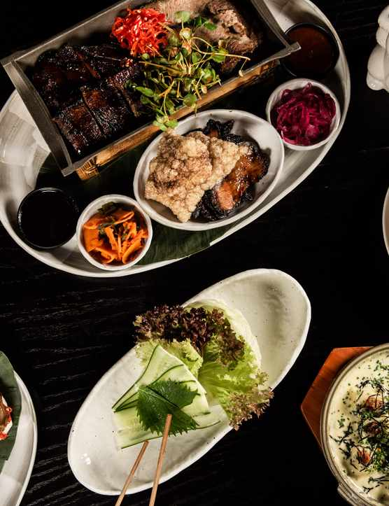 A table laden with dishes of food