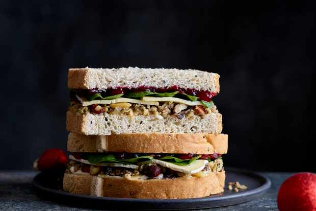 EAT Brie, Cranberry and stuffing on onion seed Christmas sandwich