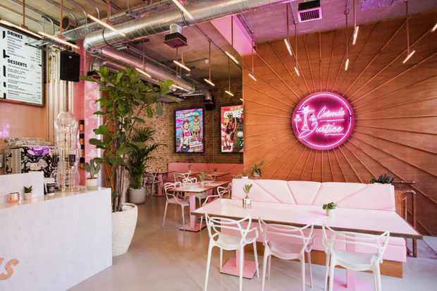 A restaurant with pink table and chairs Genesis Shoreditch Vegan Restaurant
