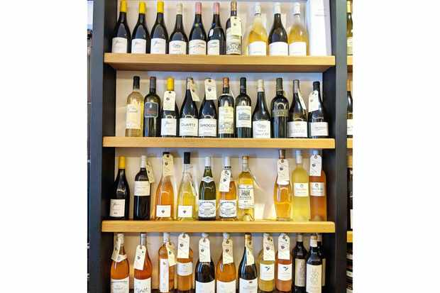 Shelves of wine bottles at Chichoulin Marseille