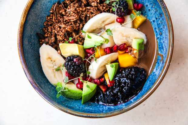 Bowl of granola, coconut yogurt and fruit at Wild Food Cafe, Islington