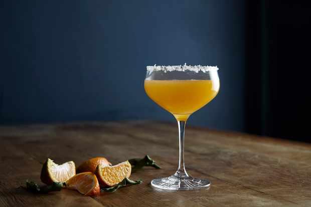 A glass full of orange liquid