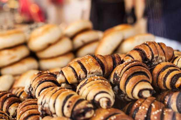 Chocolate croissants piled up on a market stall