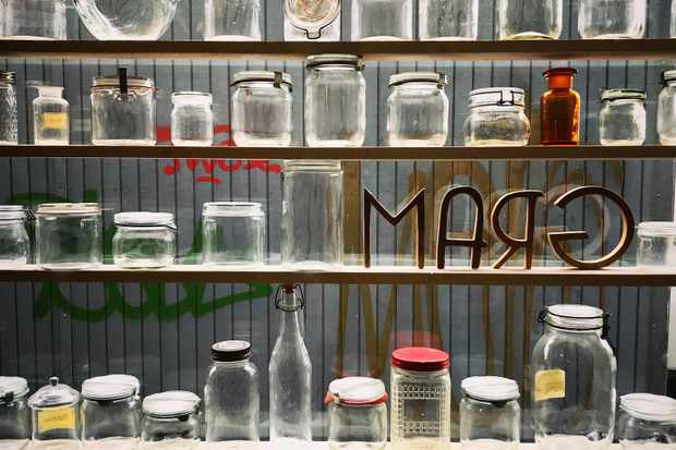 Jars lined up in a window at Gram Malmo
