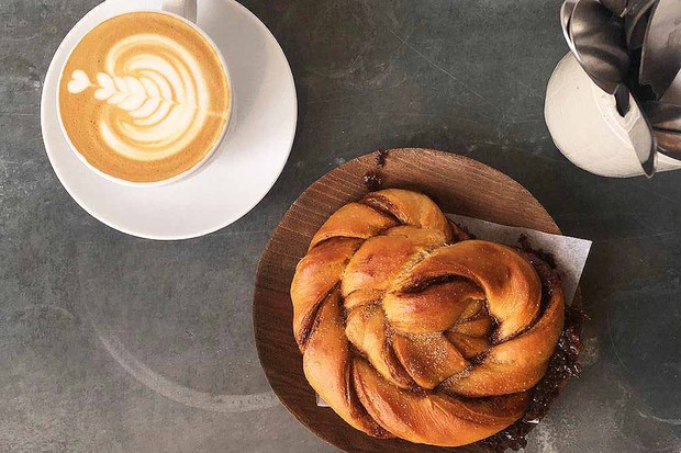 Cinnamon bun and coffee at Landrace Bakery Bath