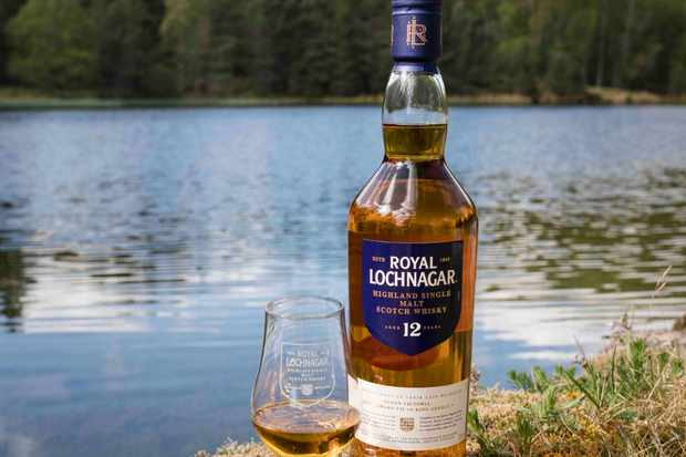 Bottle of whisky from Royal Lochnagar in front of a lake