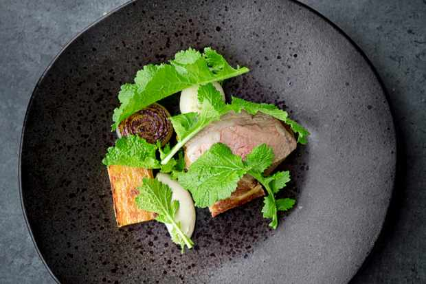 72-Hour-Cooked Lamb Belly with Braised Baby Turnips, Potato Terrine And Roasted Onion At Pensons Restaurant Herefordshire