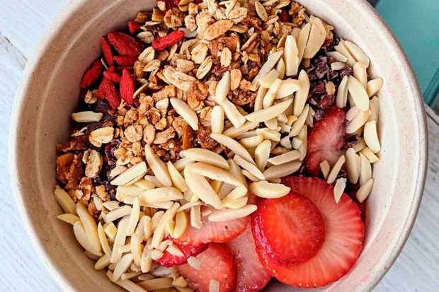 Acai bowl topped with strawberries and nuts