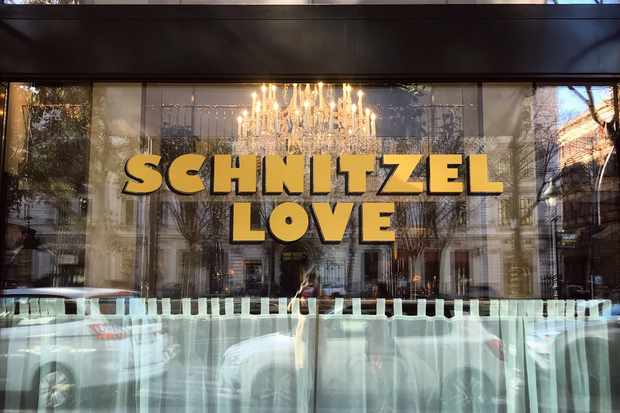 A sign saying Schnitzel Love in a window in Vienna