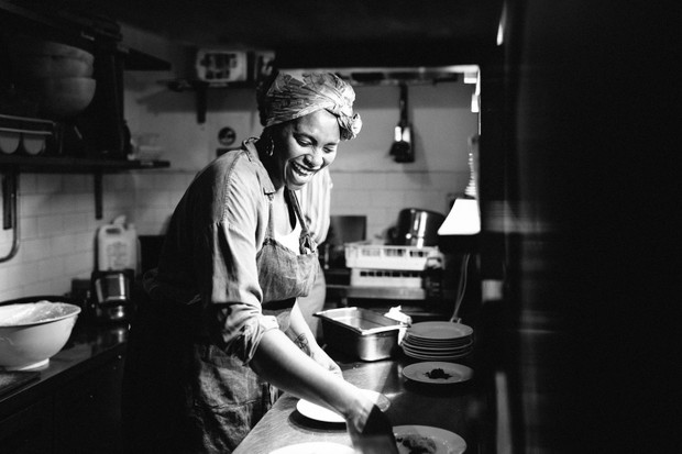 A black and white photo of Marie Mitchell, a chef in the kitchen of an east London restaurant