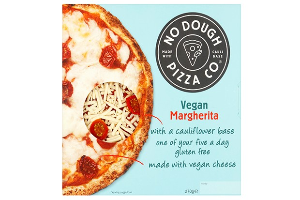A blue cardboard box with No Dough Pizza Co. written on top has a photo of a pizza with vegan cheese and tomato sauce