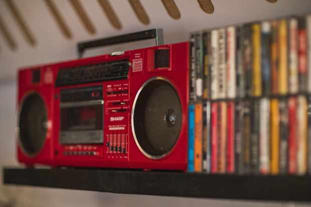 A red boombox with cassette tapes by the side of it in the Hip Hop Chip Shop, Manchester