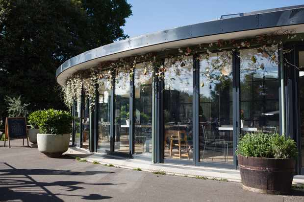 The round glass building home to Pear Tree Cafe sits next to the river in Battersea park